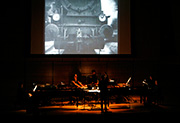11/3/07 - Helmut Imig conducts during a showing of the 1927 black-and-white silent film Berlin: Symphony of a City in Zankel (c) 2007, Jennifer Taylor